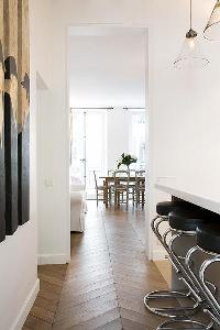 classy dining area, breakfast bar and stools in Paris luxury apartment