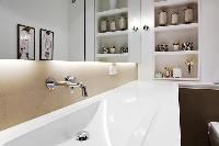 bathroom sink, mirror, and shelves in a Paris luxury apartment