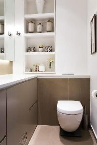 toilet with shelves and built-in cabinets in Paris luxury apartment