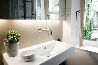 sink and mirror in a Paris luxury apartment
