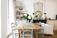 classy dining area with a table and six chairs in Paris luxury apartment
