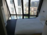 minimalist bedroom with queen-size bed in a 3-bedroom Paris luxury apartment