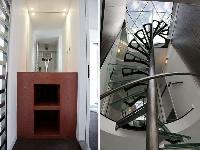 steel spiral staircases and bathroom in a 3-bedroom Paris luxury apartment
