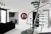 steel spiral staircases in a 3-bedroom Paris luxury apartment
