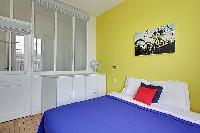 bedroom in yellow and white hues in a Paris luxury apartment