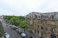 street view from the Frenchwindows of a 3-bedroom Paris luxury apartment