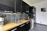 fully-equipped kitchen in a 3-bedroom Paris luxury apartment