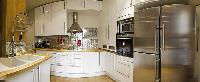warm and inviting kitchen in a 2-bedroom Paris luxury apartment
