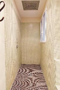 bathroom with a sink, a bathtub, built-in closets and shelves, and a separate shower area in a 2-bed
