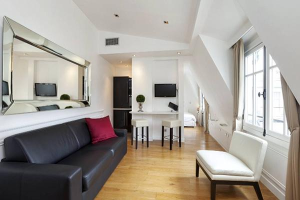 cozy studio Paris luxury apartment with immaculate white walls and natural hardwood floors