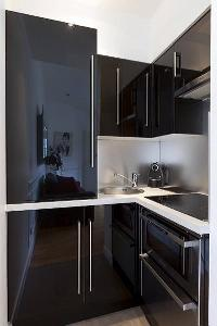 well-equipped kitchen in a  studio Paris luxury apartment