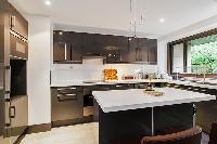 well-designed and well-equipped kitchen in a 4-bedroom Paris luxury apartment