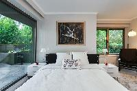 chic bedroom overlooking the courtyard  in a 4-bedroom Paris luxury apartment