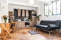 spacious living area, dining area, and kitchen in Paris luxury apartment
