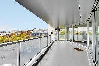 wraparound balcony with access to the living area and dining area with stunning view the Eiffel Towe