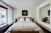 first bedroom with a double bed in Paris luxury apartment