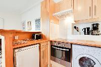 equipped kitchen in a 1-bedroom Paris luxury apartment