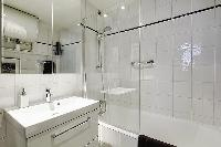 bathroom with a sink, a bathroom closet, a toilet, and a full bathtub with a detachable shower head
