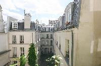 courtyard view from the French window of a a 1-bedroom Paris luxury apartment