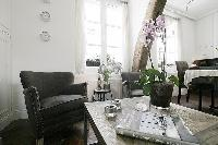classy armchairs and center table in a 1-bedroom Paris luxury apartment