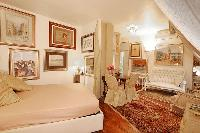a studio luxury apartment in Paris with warm beige tones and baroque furniture