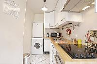 well-equipped kitchen in a 1-bedroom Paris luxury apartment