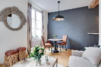 cozy living area with comfortable atmosphere 1-bedroom Paris luxury apartment