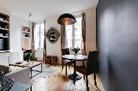 rustic dining areafor two in a 1-bedroom Paris luxury apartment