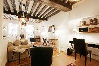 2-bedroom Paris luxury apartment with exposed antique wood beams and cream and white decor