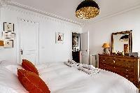 crisp and clean bedroom linens in Passy - Trocadero I luxury apartment