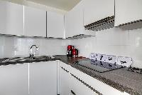 white modern kitchen in a 2-bedroom Paris luxury apartment