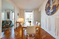chic dining set for six with accessto the living area in a 2-bedroom paris luxury apartment