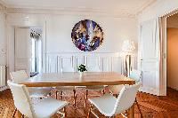 chic dining set for six in a 2-bedroom paris luxury apartment