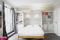 crisp and clean bedroom linens in Trocadero - Sablons luxury apartment
