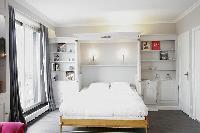 crisp and clean bedroom linens in Trocadero - Sablons luxury apartment