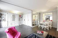 pretty button-tufted chair in Trocadero - Sablons luxury apartment