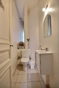 toilet in the water closet beside the kitchen in a 2-bedroom Paris luxury apartment