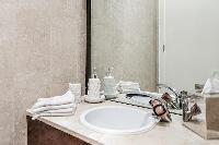 bathroom sink in a 4-bedroom paris luxury apartment