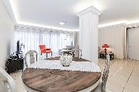 round wooden dining table in a 4-bedroom paris luxury apartment