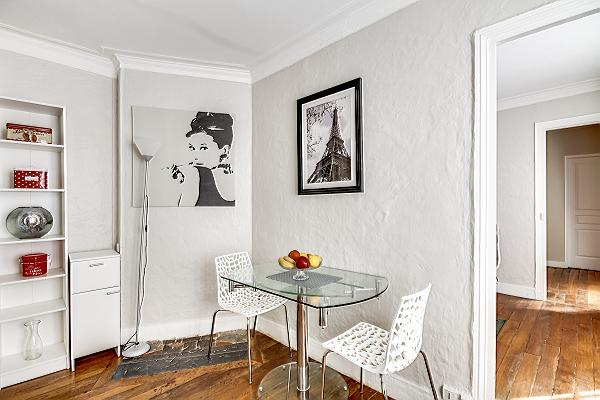 mini dining area with a table for two in a 1-bedroom Paris luxury apartment