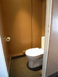 toilet in the water closet in a 2-bedroom Paris luxury apartment