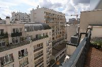 balcony with views of the Parisian cityscape and the Eiffel Tower in a 2-bedroom Paris luxury apartm