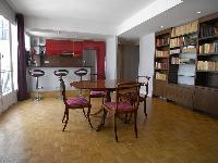 a 2-bedroom Paris luxury apartment with traditional interiors mostly wooden space with red accents