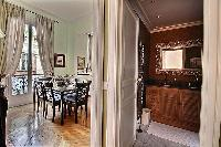 classic dining area with access to the bathroom in Paris luxury apartment