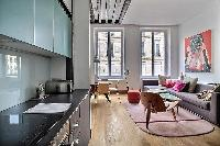 warm and artsy interiors in a 2-bedroom Paris luxury apartment