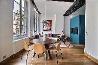 round dining set for six in a 2-bedroom Paris luxury apartment