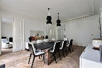 elegant 8-seater dining area in black and white hues in Paris luxury apartment