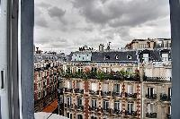 street view from the window of a 2-bedroom Paris luxury apartment
