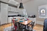 chic six-seater dining set  in a 2-bedroom Paris luxury apartment