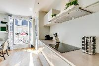 modern and immaculate white kitchen in a 2-bedroom paris luxury apartment